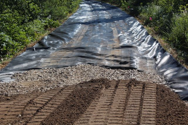 Base with geotextile fabric barrier